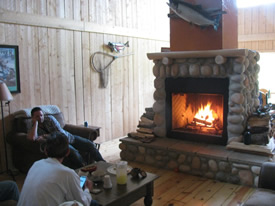 Share the day's fishing stories around our cozy stone fireplace.