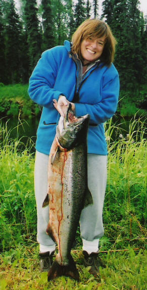 "First Alaska king salmon -- ""this is HEAVY"" -- a huge specimen fresh from the clear waters of Alaska's Deshka River"